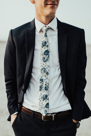 Frisco tie worn with white shirt and dark navy suit.