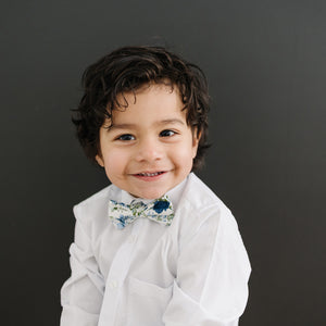 Frisco pre-tied bow tie on a young boy wearing a white shirt.