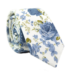 Frisco Skinny Tie. White background with small and medium size light blue flowers and sage green leaves.