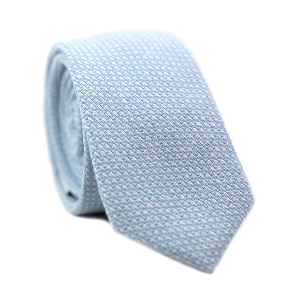 Frosted Morning Skinny Tie. Blue and white textured fabric.