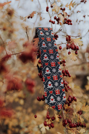 Gifted tie hanging from a tree branch.