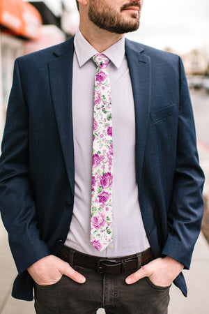 Grapevine tie worn with a light purple shirt, navy suit jacket, black belt and gray jeans.