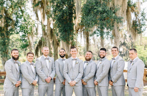 Green Floral Bow Tie worn by nine groomsmen at a wedding with white shirts and light gray suits.