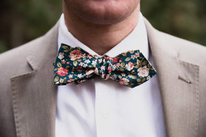 Green Floral Bow Tie worn with a white shirt and tan suit jacket.