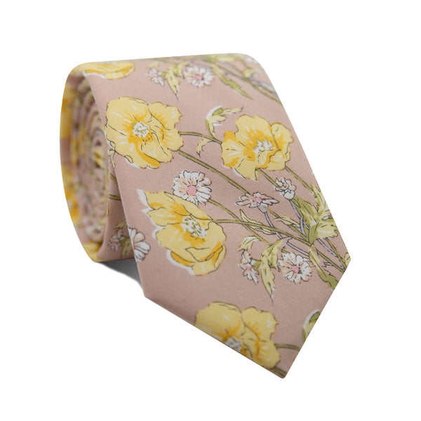 Hawaiian Honey Skinny Tie. Blush background with yellow and white flowers and green leafy stems.