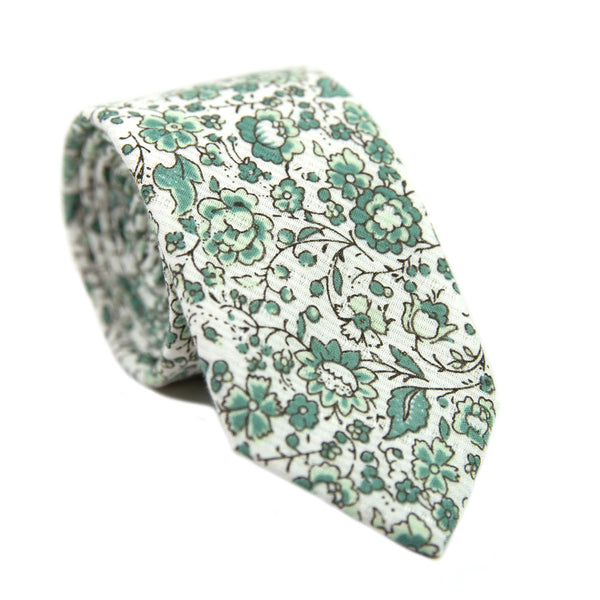 Hidden Garden Skinny Tie. White background with sage green flowers and leaves with black vines.