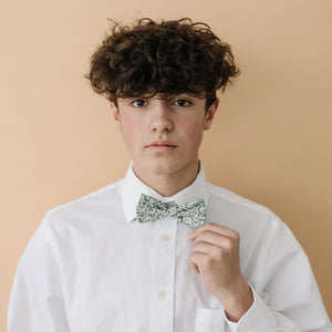 Hidden Garden pre-tied bow tie worn with a long sleeve white shirt.