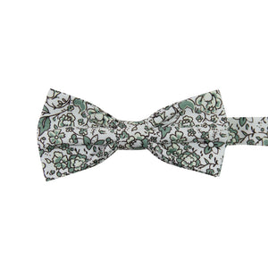 Hidden Garden Pre-Tied Bow Tie. White background with sage green flowers and leaves with black vines.