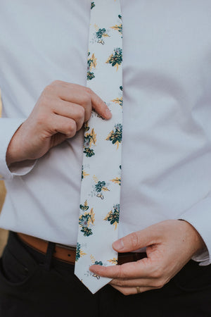 Honeysuckle tie worn with a white shirt, brown belt and black pants.