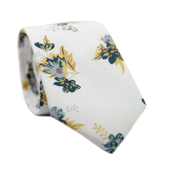 Honeysuckle Skinny Tie. White background with yellow, lavender, and teal flowers.