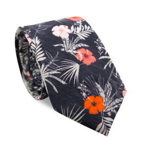 Islander Skinny Tie. Navy blue background with pink, orange and white flowers and light gray palm leaves.