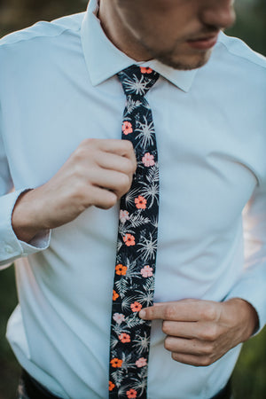 Islander tie worn with a white shirt.
