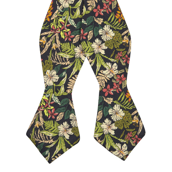 Jumanji Self Tie Bow Tie. Grayish background with white, green, red, orange and yellow jungle leaves over the entire tie.