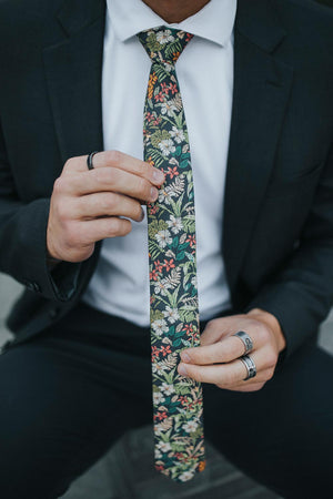 Jumanji tie worn with a white shirt and dark gray suit.