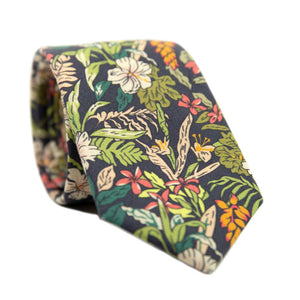 Jumanji Skinny Tie. Grayish background with white, green, red, orange and yellow jungle leaves over the entire tie.