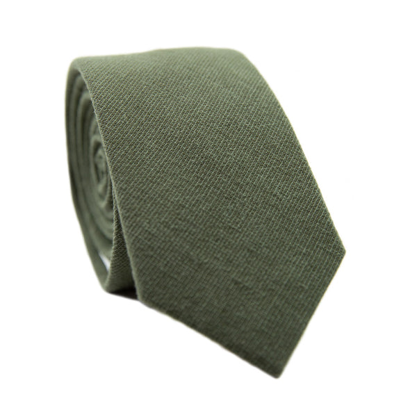 Jungle Skinny Tie. Solid green textured fabric.
