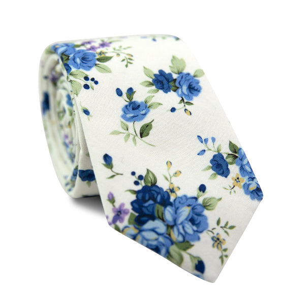 Laguna Skinny Tie. White background with blue and purple flowers and green stems and leaves.