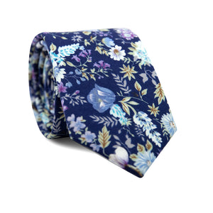 Lilac Skinny Tie. Navy background with blue, purple and white flowers, and green leaves and branches.