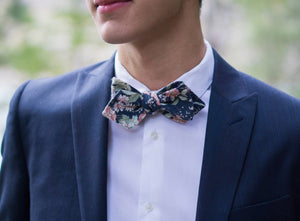 Lotus Bow Tie worn with a white shirt and navy suit jacket.