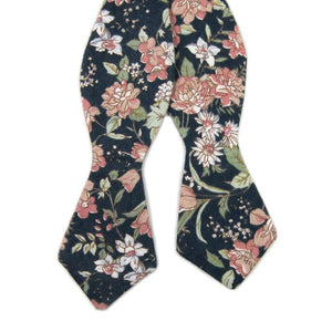Lotus Self Tie Bow Tie. Navy background with white and blush pink flowers and sage green stems and leaves.