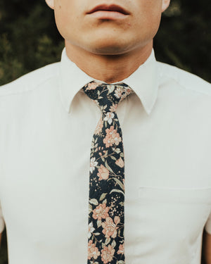 Lotus tie worn with a white shirt.