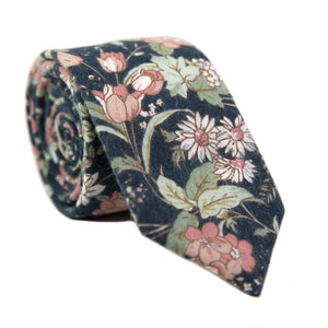 Lotus Skinny Tie. Navy background with white and blush pink flowers and sage green stems and leaves.