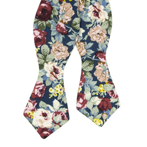 Mardi Self Tie Bow Tie. Navy background with yellow, red, and cream flowers and blue leaves.