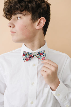 Mardi pre-tied bow tie worn with a white long sleeve shirt.