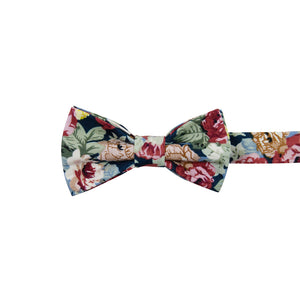 Mardi Pre-Tied Bow Tie. Navy background with yellow, red, and cream flowers and blue leaves.