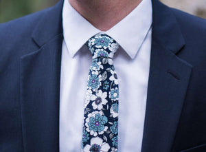 Moonlight Daisy tie worn with a white shirt and navy suit jacket.