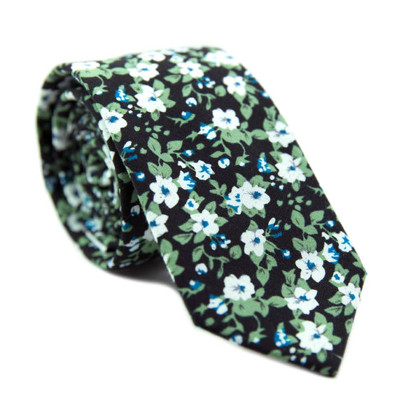 Morning Glory Skinny Tie. Black background with white flowers, blue flower center, and green leaves.