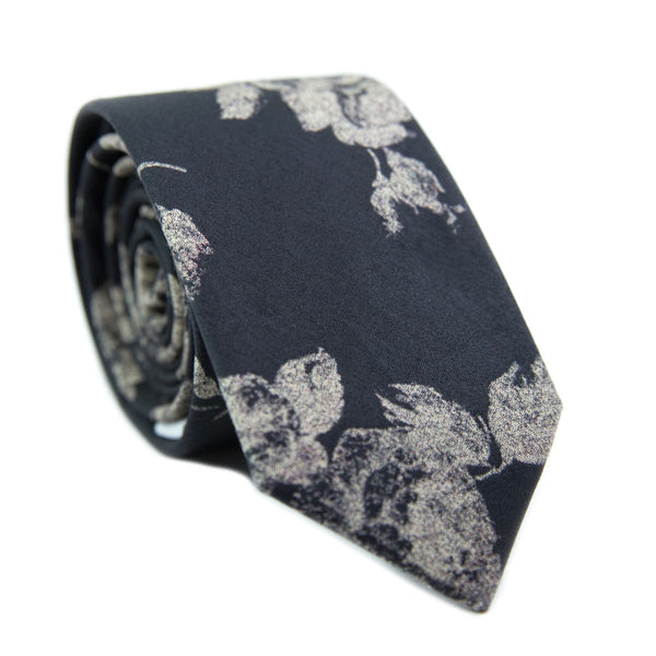 Nightfall Skinny Tie. Black background with big cream flowers.