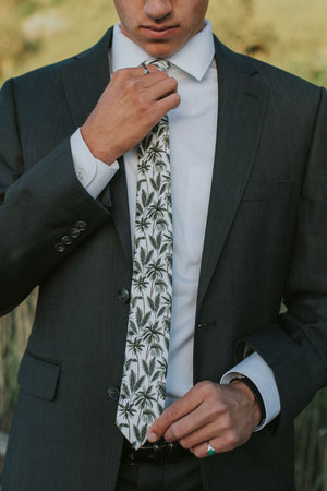 Oasis tie worn with a white shirt and dark gray suit.