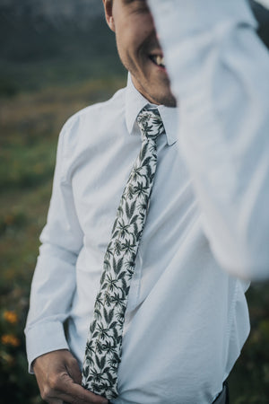 Oasis tie worn with a white shirt.