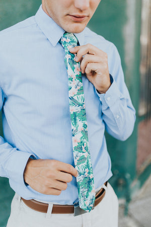 Pacific tie worn with a light blue shirt, brown belt and light tan pants.