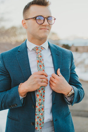 Painted Perennials tie worn with a white shirt, blue blazer and light blue pants.
