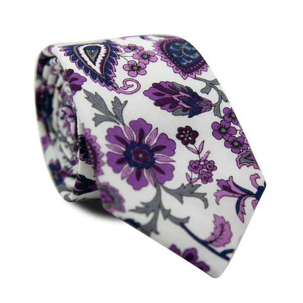 Paisley Daze Skinny Tie. White background with purple and gray flowers and some purple paisley designs.