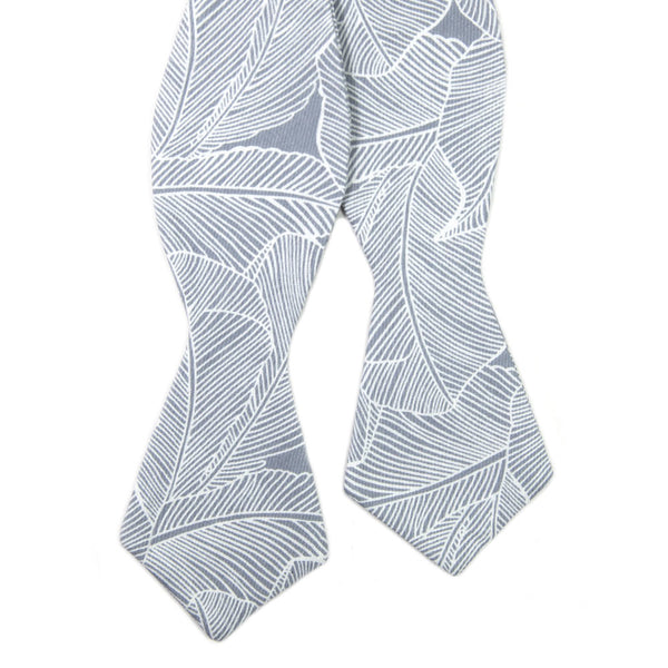 Palm Self Tie Bow Tie. Blue/gray background with white palm leaf pattern over entire tie.