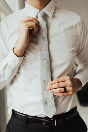 Palm tie worn with white shirt, black belt and black pants.
