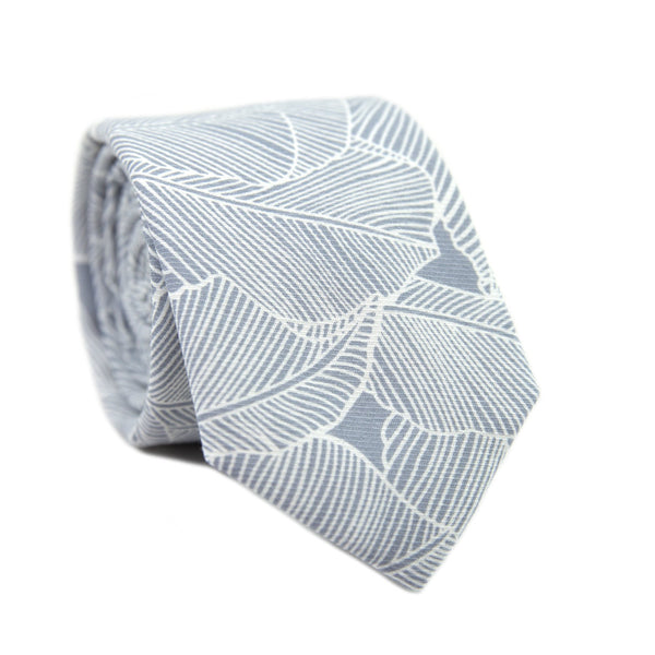 Palm Skinny Tie. Blue/gray background with white palm leaf pattern over entire tie.