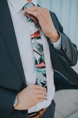 Picasso tie worn with a white shirt and dark gray suit.