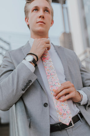 Pink Meadow tie worn with a white shirt, black belt and gray suit.
