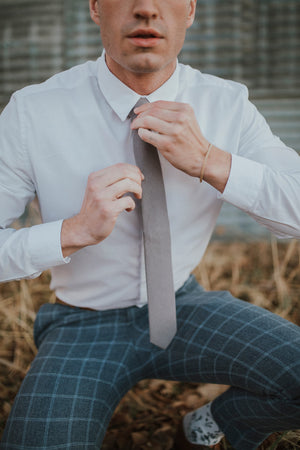 Portobello tie worn with a white shirt and blue checkered pants.