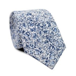 Powder Skinny Tie. White background with small navy and dusty blue flowers and black stems.
