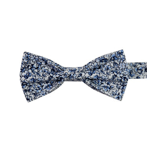 Powder Pre-Tied Bow Tie. White background with small navy and dusty blue flowers and black stems.