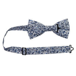 Powder Pre-Tied Bow Tie with adjustable neck strap. White background with small navy and dusty blue flowers and black stems.