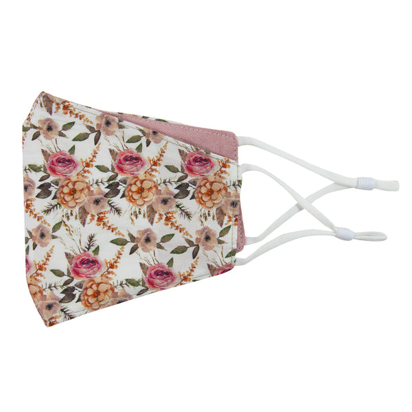 Quicksand Roses and Blush Reversible Face Mask. Outside is white background with mauve, peach and blush pink flowers. Sage green leaves and branches throughout. Inside is solid blush pink textured fabric. White adjustable straps to loop over ears.