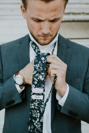 Rio tie worn with a white shirt and gray suit jacket.