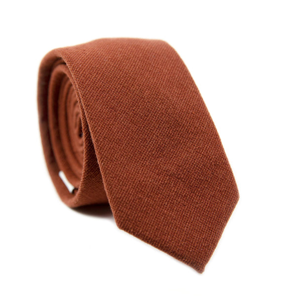 Rust Skinny Tie. Solid burnt red/orange textured fabric.