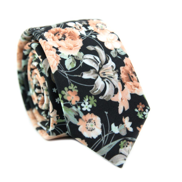 Secret Garden Skinny Tie. Black background with light orange flowers, white and gray flowers, and green leaves.